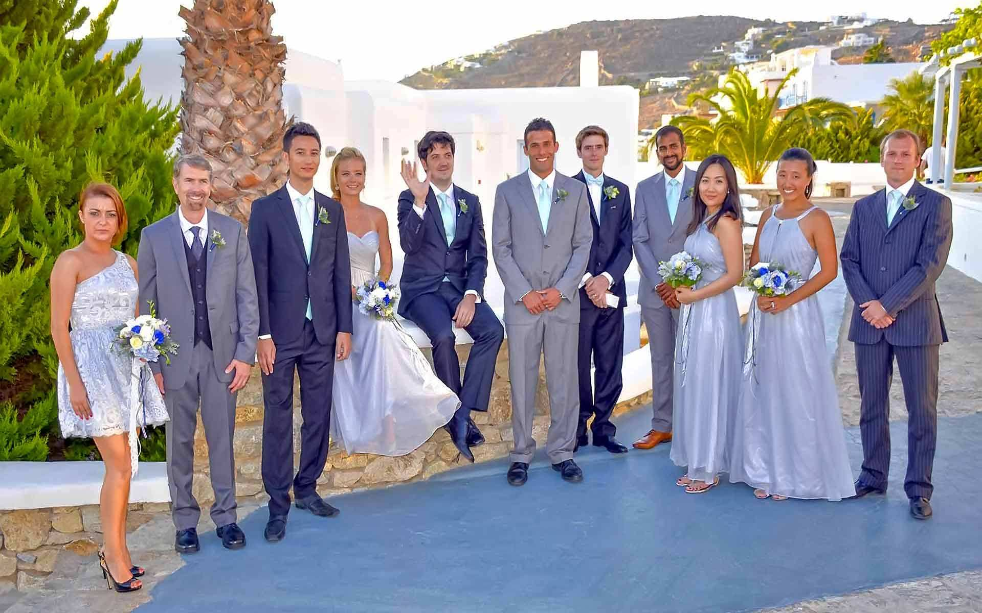 Bridesmaids-Groomsmen-Are-Waiting-For-The-Bride-To-Walk-Down-The-Aisle-In-Mykonos-Wedding