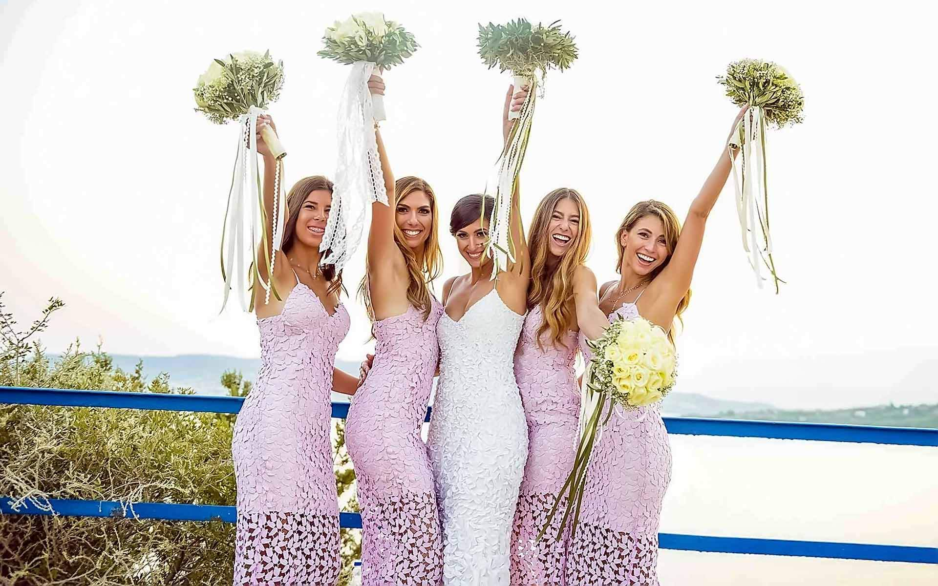 Happy-Bridesmaids-With-The-Bride-Are-Posing-by-Diamond-Events