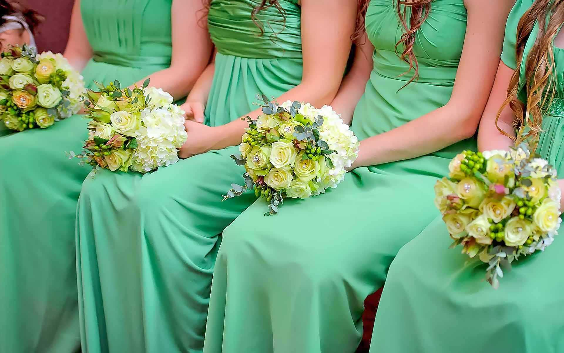 Ladies-In-Emerald-Each-Dressed-Up-Holding-Their-Wedding-Bouquets