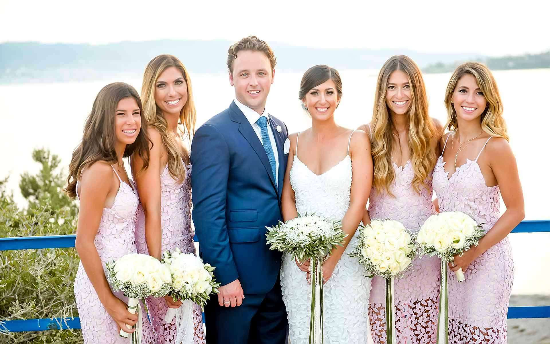 The-Couple-With-Their-Bridesmaid-Holding-Their-Wedding-Bouquets-With-White-Roses-With-Olive-Leaves-With-Olive-Leaves