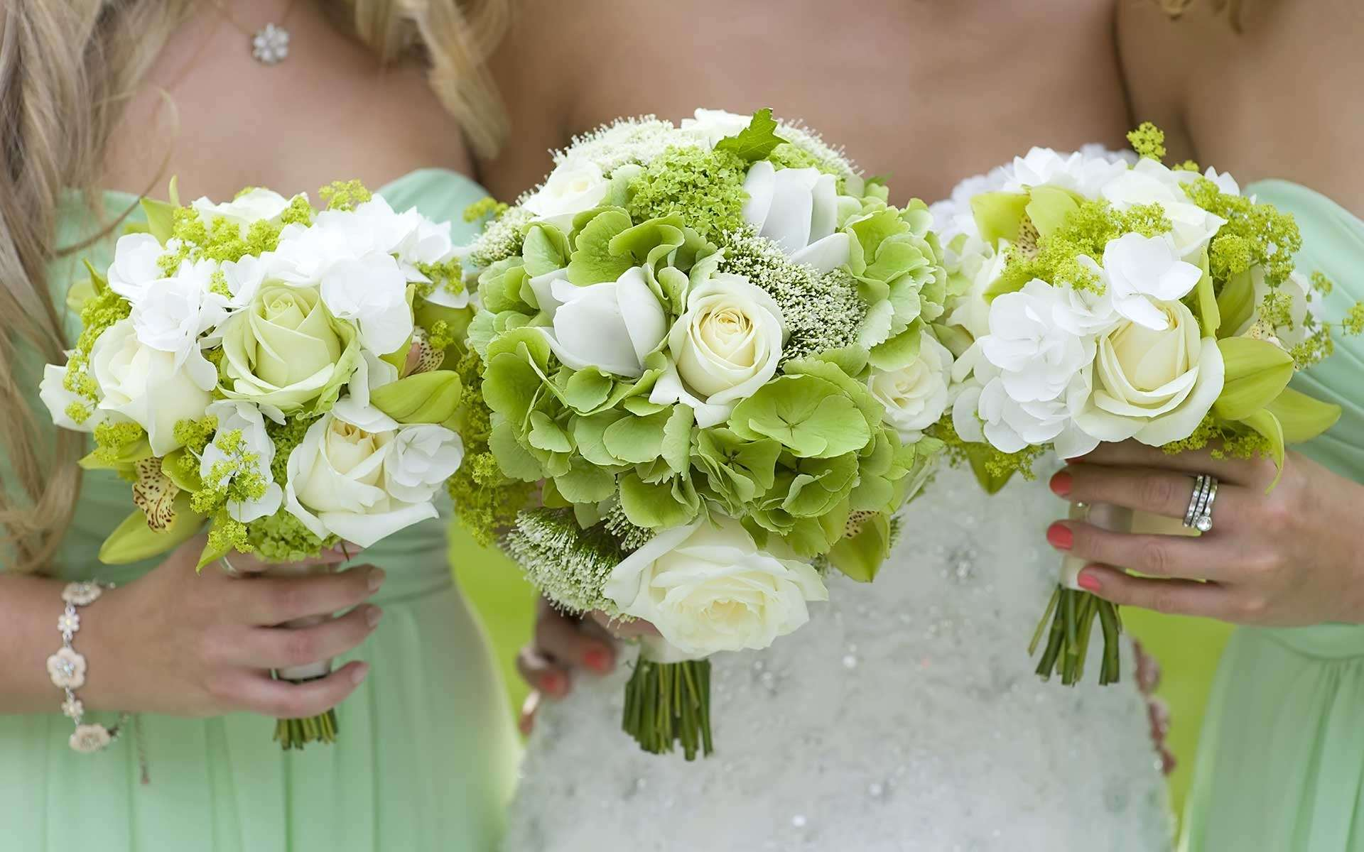 White-Roses-Seamlessly-Peak-Through-Green-Hydrangeas-A-Pinch-Of-Baby's-Breath-Adds-Texture-To-These-Bridal-Bouquets