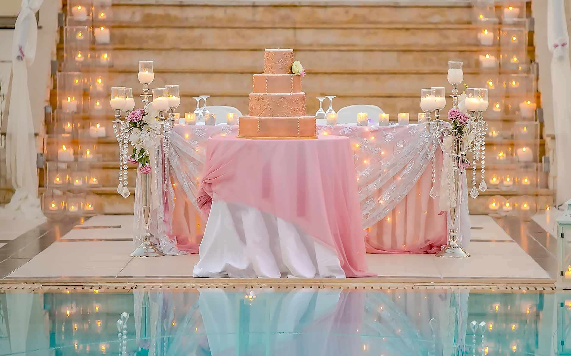 Golden-Wedding-Cake-Set-Up-In-Front-Of-The-Bridal-Table-by-Diamond-Events-Wedding-Event