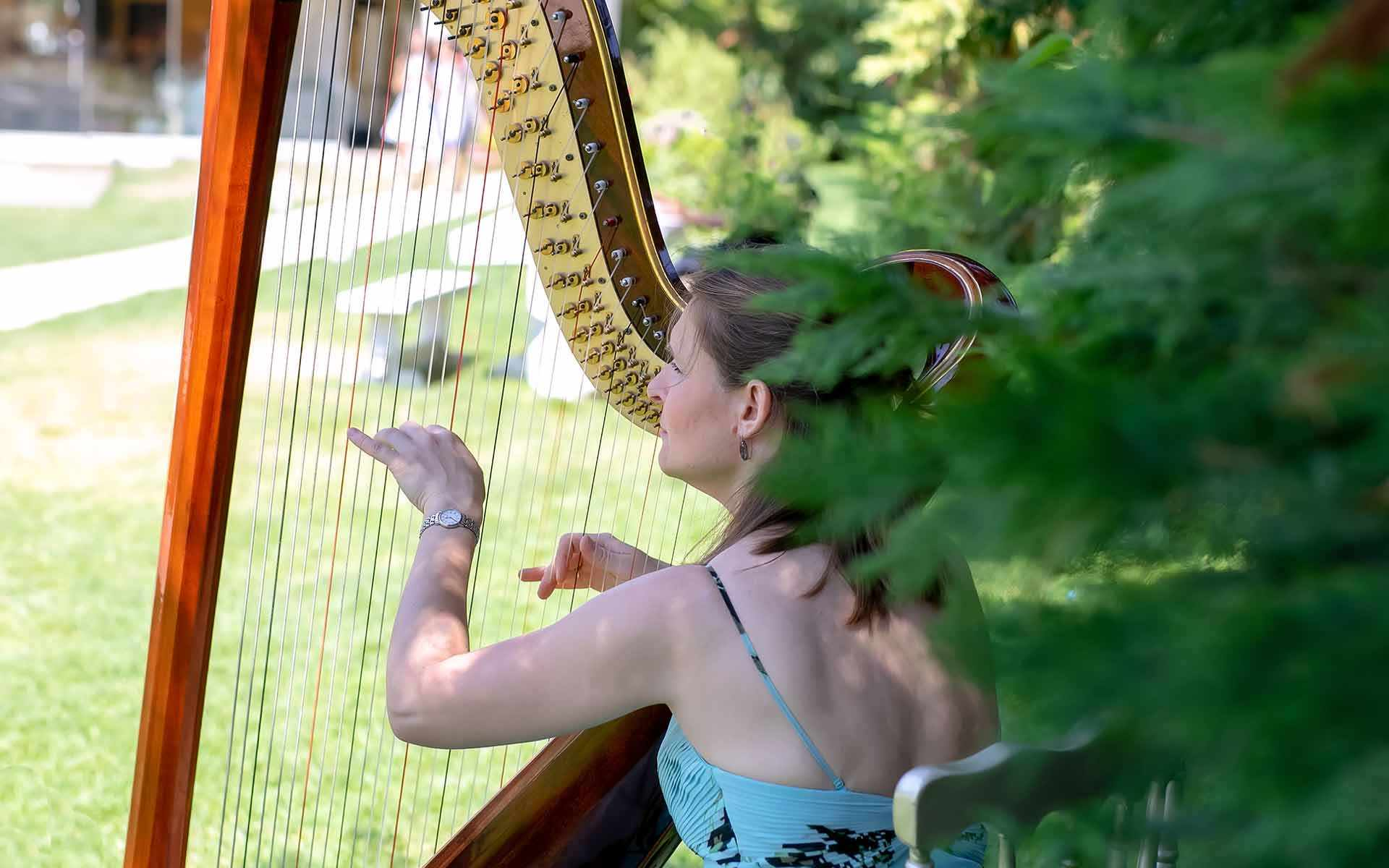 A-Harpist-at-a-wedding-ceremony-in-Ktima-Erofili-Tatoi-Athens-by-Diamond-Events