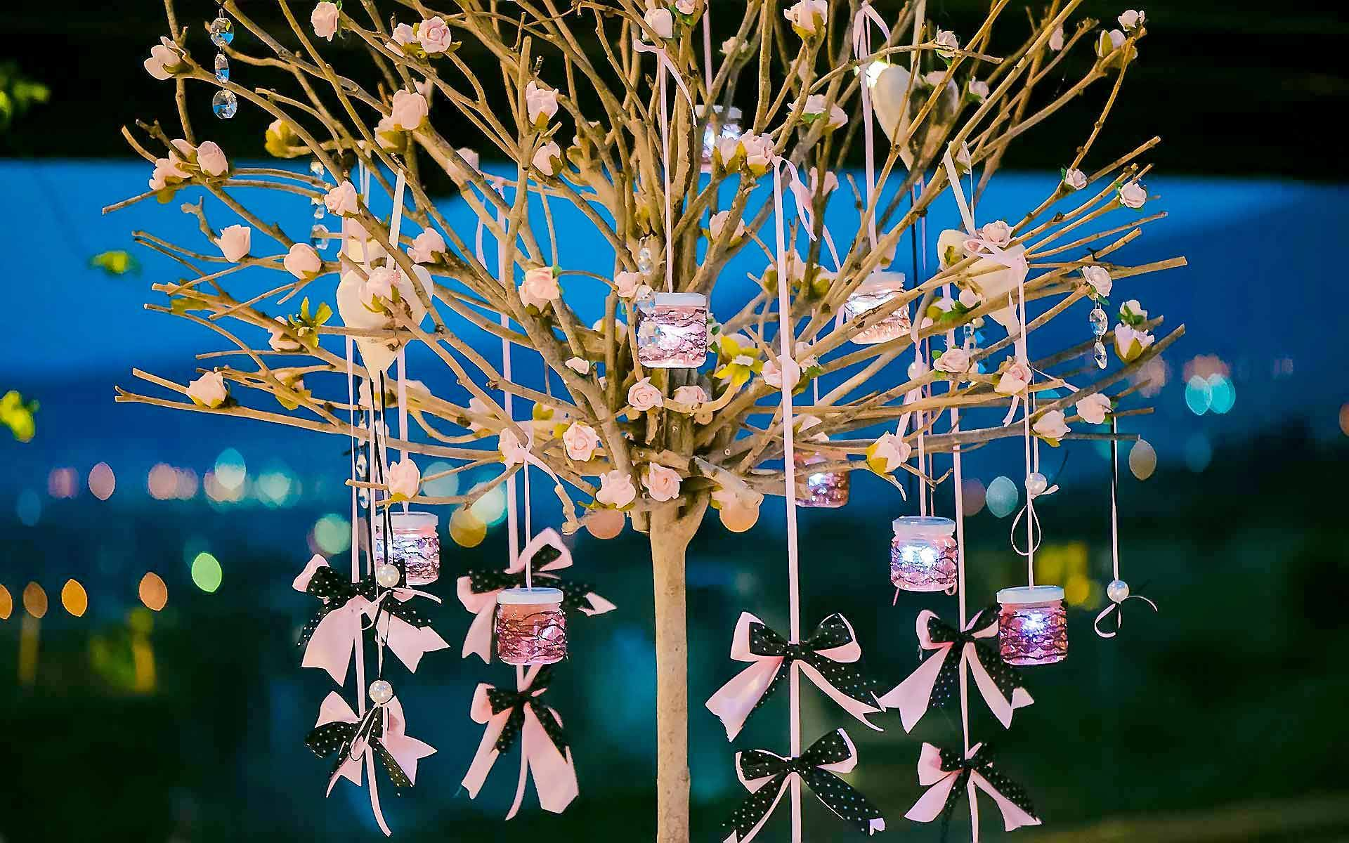 A-Tree-Draped-With-Hearts-And-Baby-Roses-Bows-And-Candles-by-Diamond-Events-christening