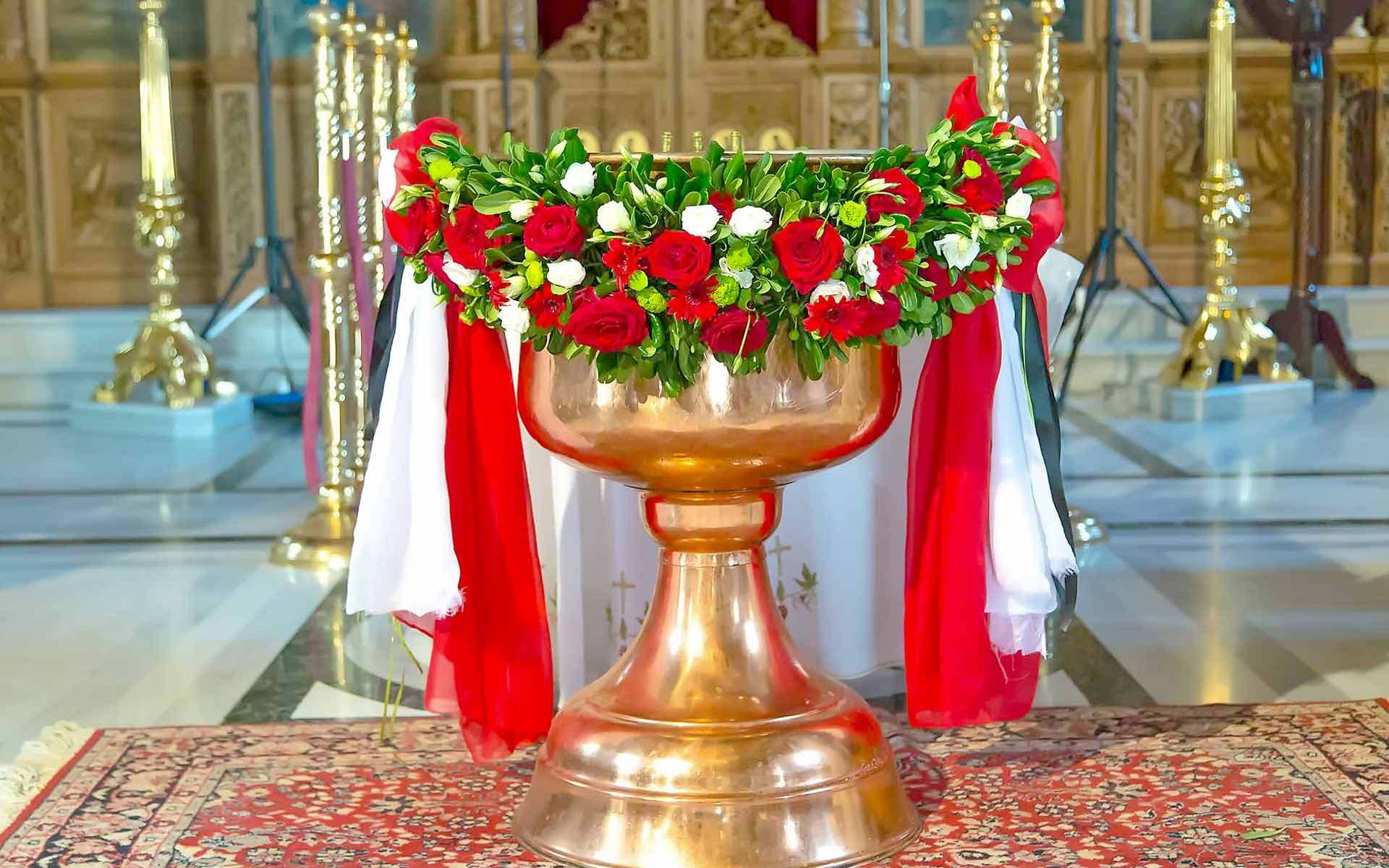 Enchanting-Golden-Gilded-Baptismal-Basin-Surrounded-By-Red-And-White-Roses-Draped-In-Chiffon