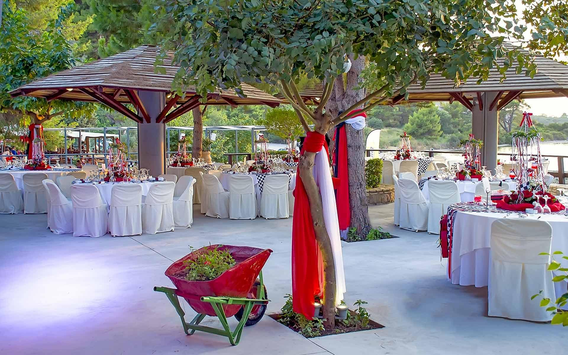 Poco-Poco-Venue-Christening-Set-Up-With-Red-Flowers-And-Flags