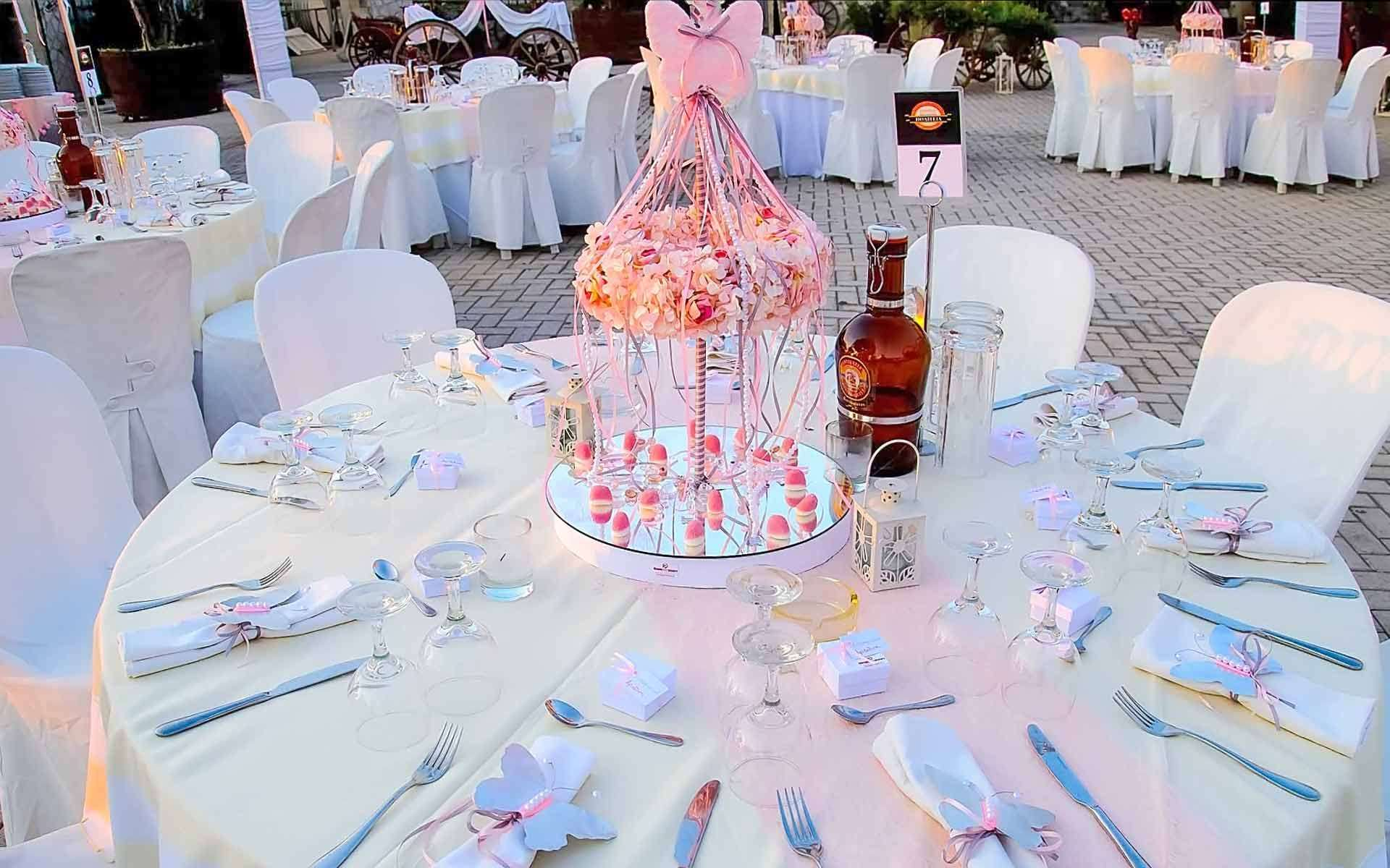 Table-Decoration-With-Pink-Carousel-In-Shades-Of-Pink-With-Floral-Wreath-And-Pink-Ribbons