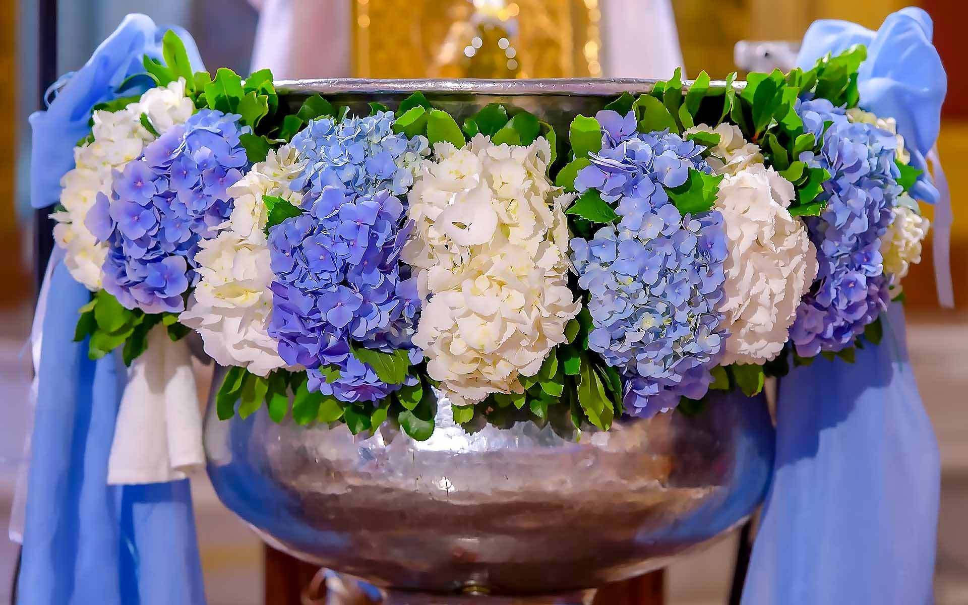 The-Silver-Baptismal-Basin-Accentuates-The-Beautiful-Blue-And-White-Hydrangeas