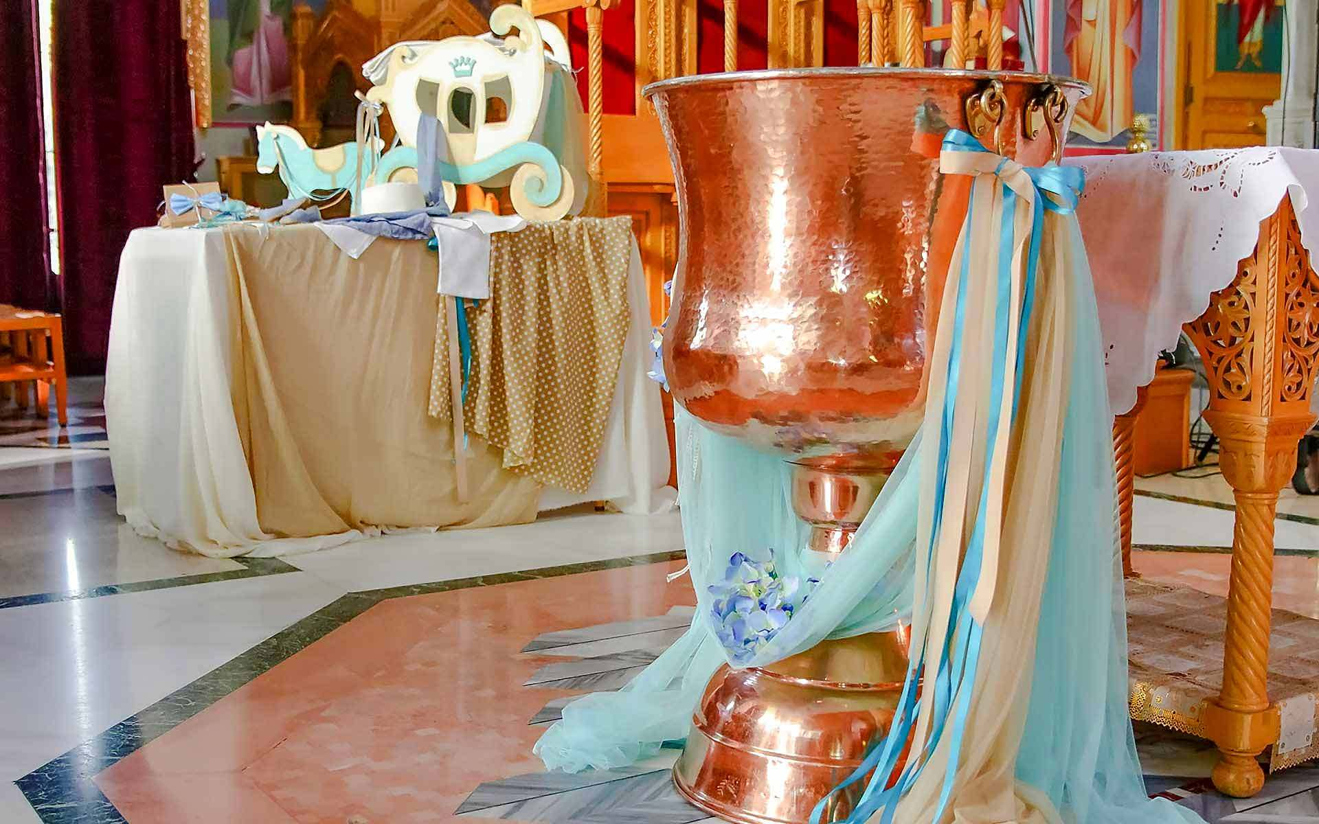 Turquoise-Fabrics-And-Ribbons-And-Blue-Hydrangeas-Are-Uniquely-Combined-To-Decorate-A-Rose-Gold-Baptistery