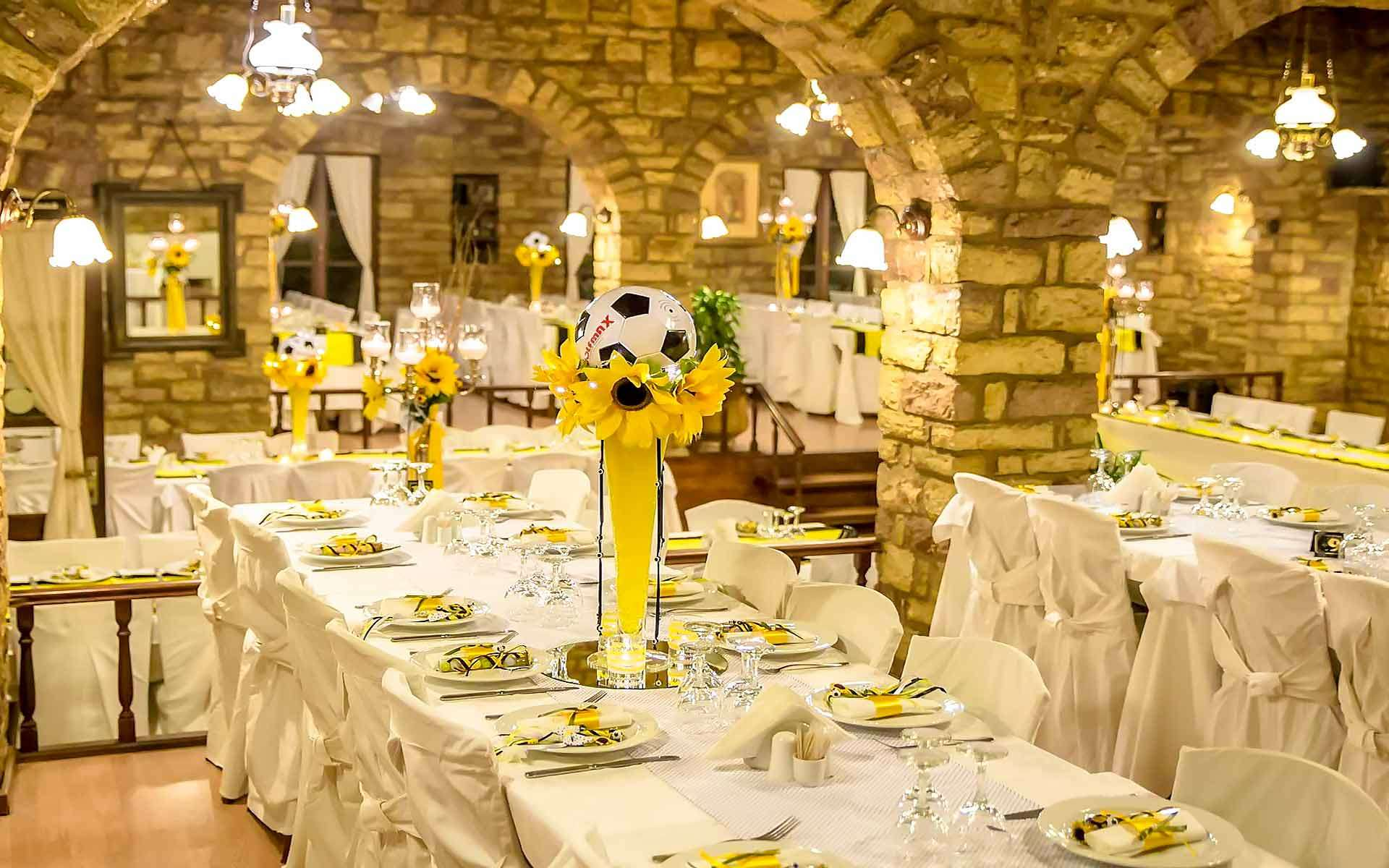 Unique-Baptism-Party-Idea-With-Yellow-And-Black-Colors-And-A-Ball-As-A-Centerpiece-In-A-Tall-Vase