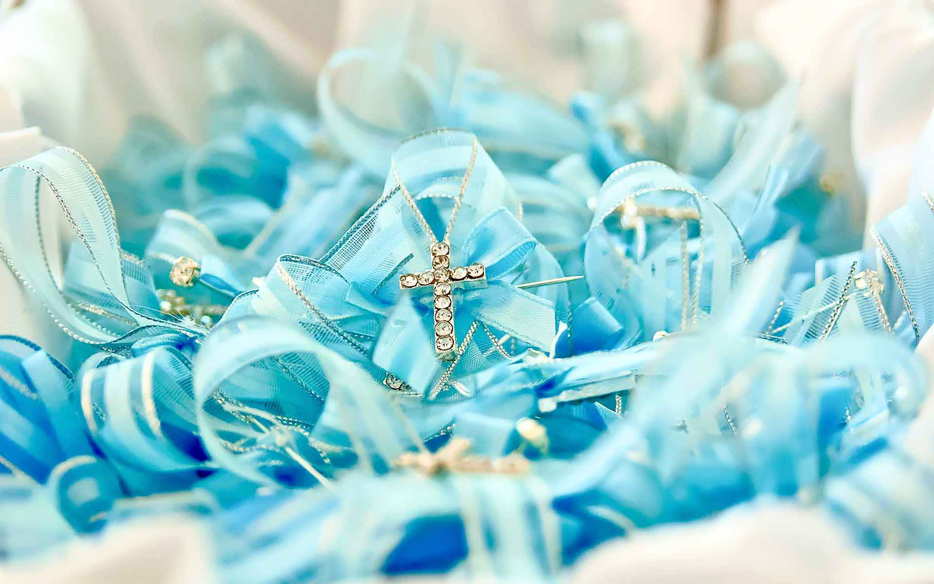 Witnessing-A-Baptism-Is-A-Blessing-Honorary-Guests-Are-Greeted-With-Beautiful-Crystal-Cross-And-Blue-Ribbon-Pins