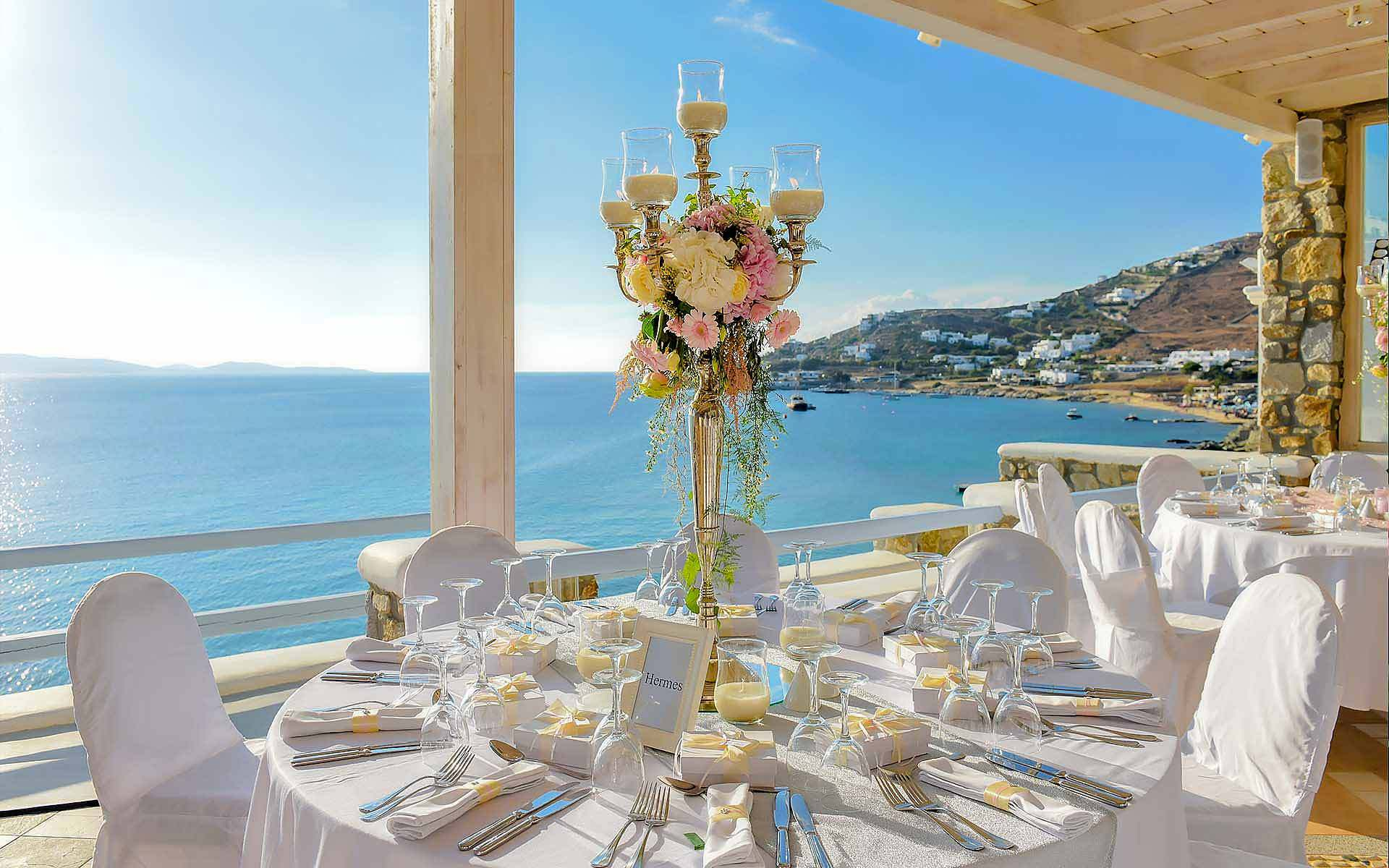 Candelabra-As-A-Centerpiece-With-The-Sea-Of-Mykonos-As-A-Background