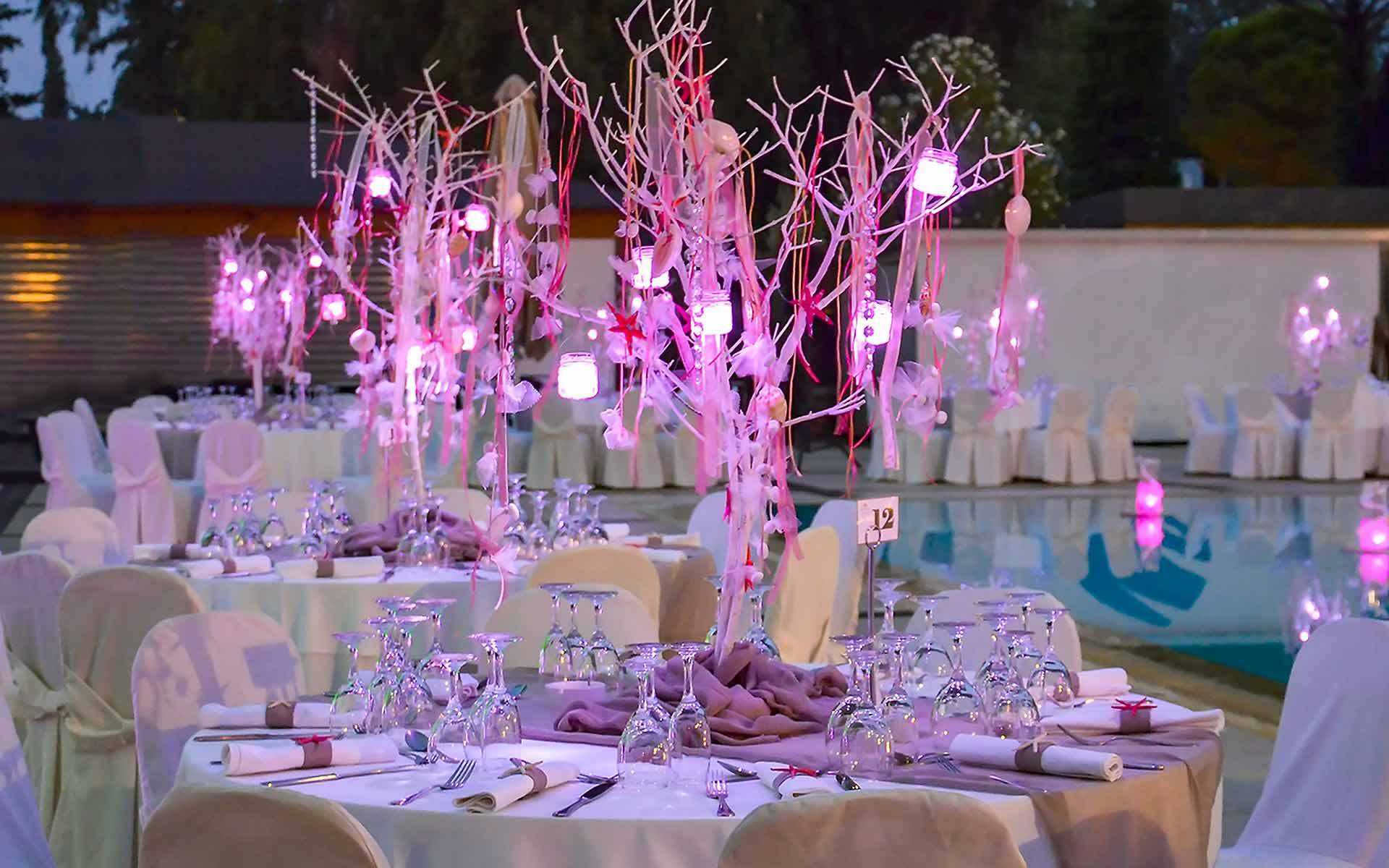 Corals-In-Trees-In-Purple-Lighting-As-A-Centerpiece-In-A-Beach-Wedding