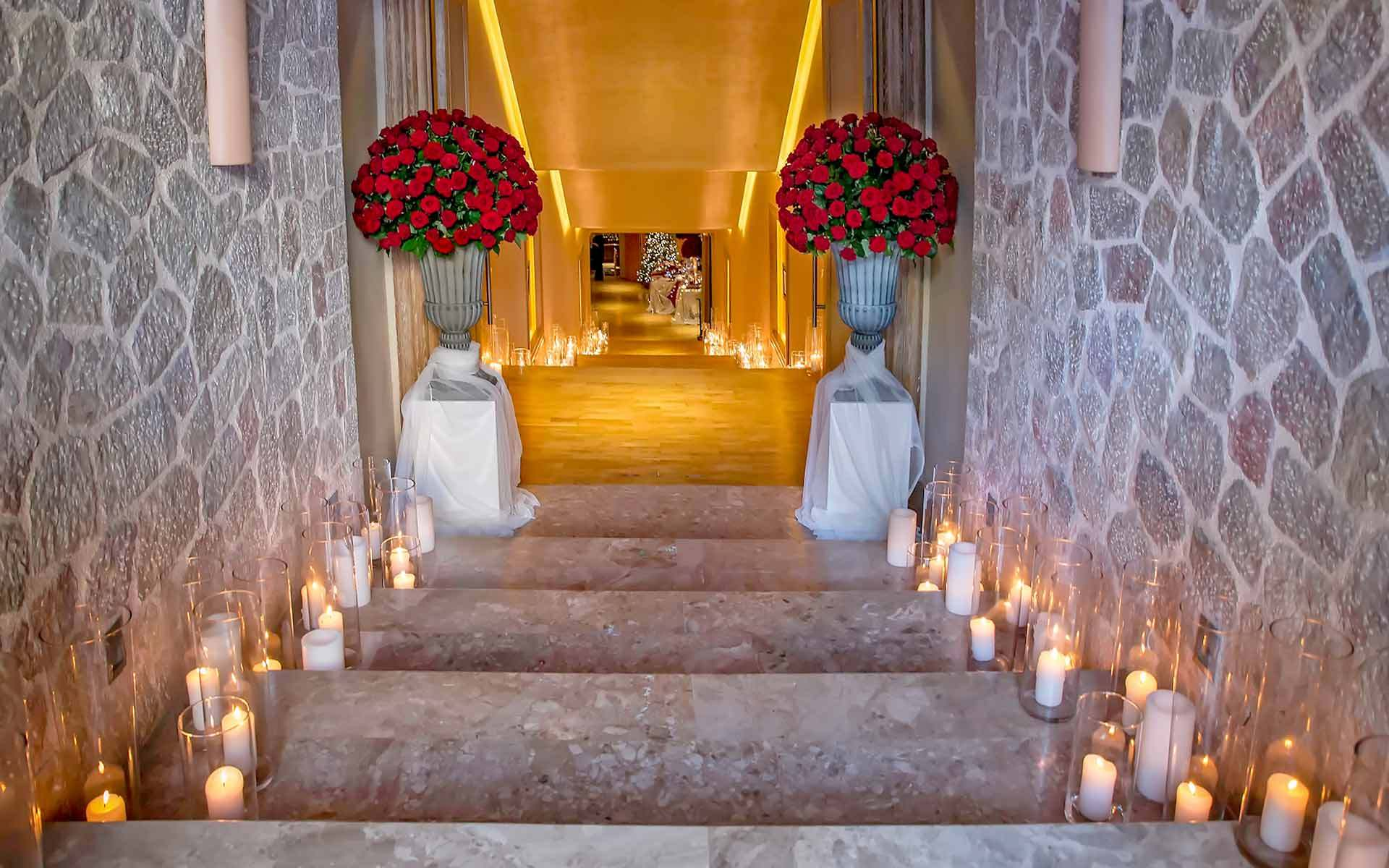 Entrance-Of-Candles-And-Red-Roses-For-A-Royal-Wedding