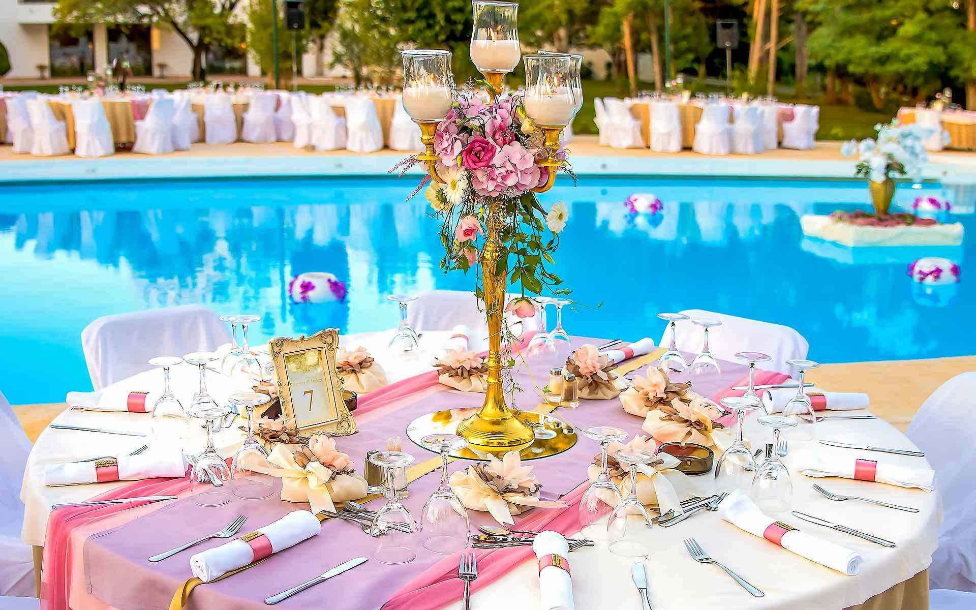 Gold-candlestick-centerpiece-in-pastel-colors-by-Diamond-Events