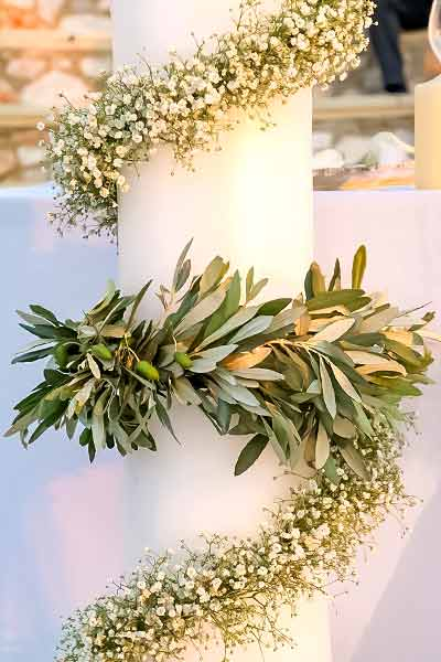 Wedding-candle-decorated-with-olive-leaves-and-gypsophilia-by-Diamond-Events